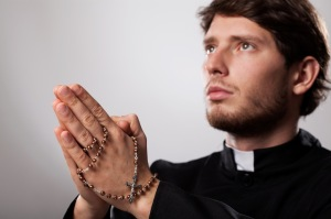 Priest with rosary